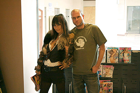 Bai Ling with customer